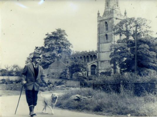Bob Sutton walking past Bottesford Church