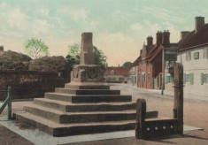 Postcard of Bottesford Cross and Stocks, with Acacia Farm and the Bull in the background