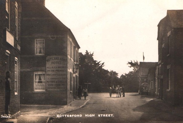 Postcard of the High Street and Rutland Arms