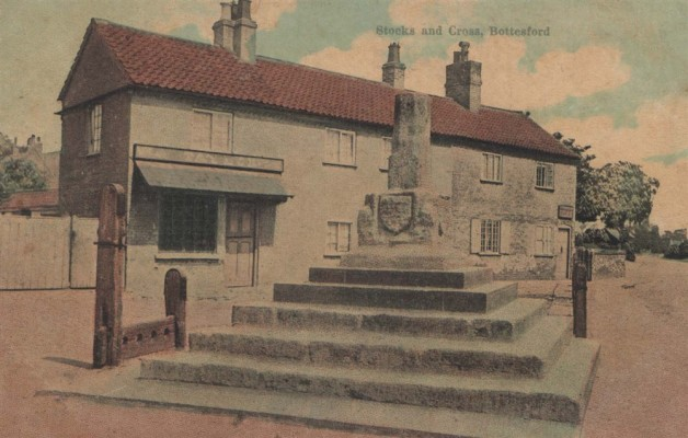 The Cross and Stocks, with Taylor's and Sutton's shops behind