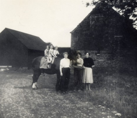 Calcraft family by the barns at Sykes Lane Farm, Muston