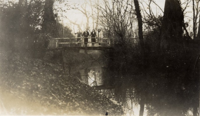Members of the Blackmore family standing on the Rectory bridge
