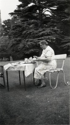 Mrs Blackmore taking tea in the Rectory garden