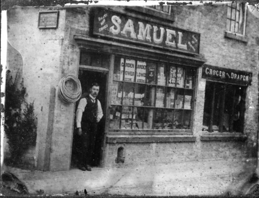 William Samuel standing in the shop entrance