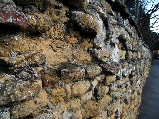 Rectory Wall, Church Street, probably built in the 17th Century, mostly of soft, honey-brown Marlstone Rock.