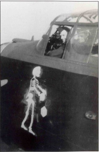 F/Sgt Brian Howie RAAF sits in the cockpit of his usual aircraft, 'AApple' ED541. Already operational on 50 Squadron, it was hoped that the macabre artwork would bring the crew good luck on their posting to 467: they completed their tour on 9th March 1943 - the first to do so