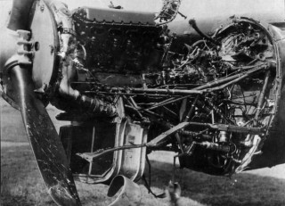 The morning after ..... All too obvious Flak damage to the starboard outer engine of Lancaster LM310 following S/Ldr Keith Thiele's crash-landing at Coltishall in the early hours of 13th May 1943