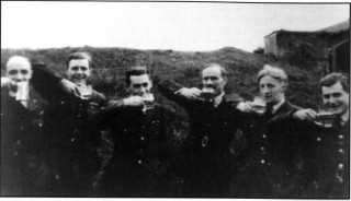 Celebrations for the award of Keith Thiele's DSO - the first on 467 Squadron. Raising a glass are, left to right: 'Jock' Murray (Mess landlord), Cosme Gomm, Keith Thiele, Group Captain McKechnie, Don MacKenzie and 'Ray' Raphael. Within a few months four of the six would be dead