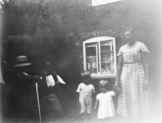 The Bray's house, Muston. Uncle Joe Hollingworth, Francis Bray, Gerald Coy, unknown and Winnie Coy, c. 1935.