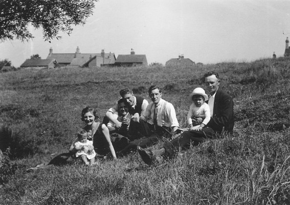 June 1934 on the river bank in the field behind the Bray's house Muston, looking towards Hospital Cottage and the A52. L to R: Gloria Taylor, Annie Bray, William (Bill) Bray, Len Abbott (Annie's fiancee), Fred Taylor, Gerald & Walter Coy.
