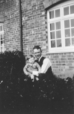 Walter Coy with Gerald Coy in their front garden, 1933. This is now 12 Main Street.