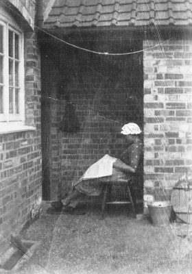 My grandmother Winnie Coy at the back door of their house on Main Street, Muston. I remember this with a porch and a huge rainwater tank to the right which I wasn't allowed to drain!