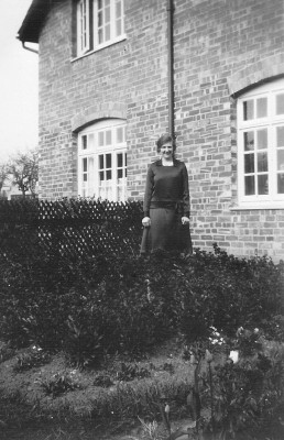 Winnie Coy in the front garden of what is now 12 Main Street Muston, 1933.