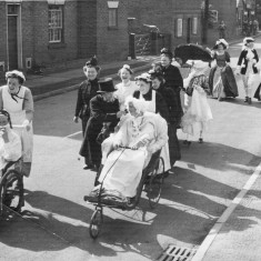 On left Mrs Edna Taylor pushing Mrs Reuben Jackson in a wheel chair. Ladies in black are Mrs Singleton and Mrs Emily Rayson. Between them in white is Mrs Joan Waudby. Behind in black is Mrs Emily Jackson. The three costumed ladies to the rear are Mrs Ada Bond, Mrs Edna Daybell and Mrs May Green