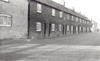 Butcher Row, High Street in the 1960s. Just visible on the left is the gable end of No 13 where William Sutton had his premises - now demolished.
