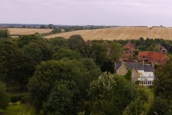 Looking northwards from the tower in 2014. This shows the same view, but the railway is largely hidden by the trees that have grown. Beckingthorpe House is clear, but there is now housing on the old paddocks as well as rebuilding of buildings of the old farmyard.