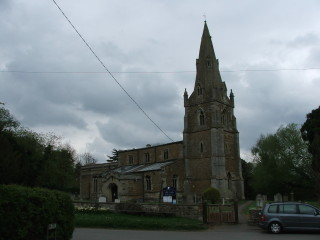 Muston church with the war memorial near to the gate