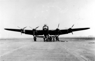 A No 207 Squadron Lancaster and crew on the runway at Bottesford.