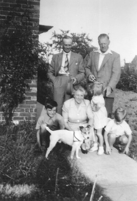 The Coy's house Main Street, Muston, 1949. John Bray, Walter & Winnie Coy, Susan, Bill and Cyril Bray with Spot in the foreground.
