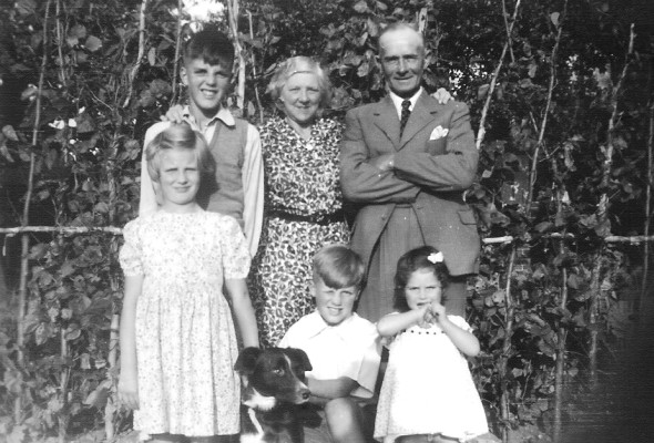 My grandparents Winnie & Walter Coy with Susan, John and Cyril Bray. Unknown girl to the right and Spot in the foreground. 1949.