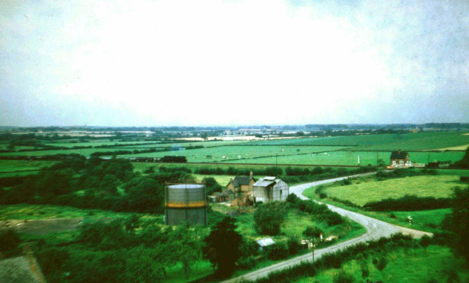 Looking north in 1956 This picture shows a steam-hauled passenger train traveling westwards bound for Nottingham, beyond the house and outbuildings of Beckingthorpe Farm, which was still very much an active farm owned by Mr Philip Marsh. | Michael Bradshaw