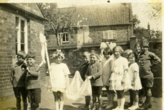 May Day procession in the 1920/30's - Mrs Ada Bond recalls that the May Queen was Eva Randall; others in the procession include George Taylor, Ralph Bateson, Joan Tuckwood (Mrs Joan Roberts), Betty Waudby and Bill Waudby