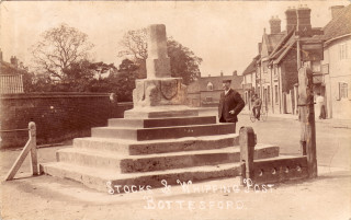 The Cross, Bottesford. Left the wall of the school and beyond  Accacia House and its stock yard. Right The Bull Innand the Coffee House