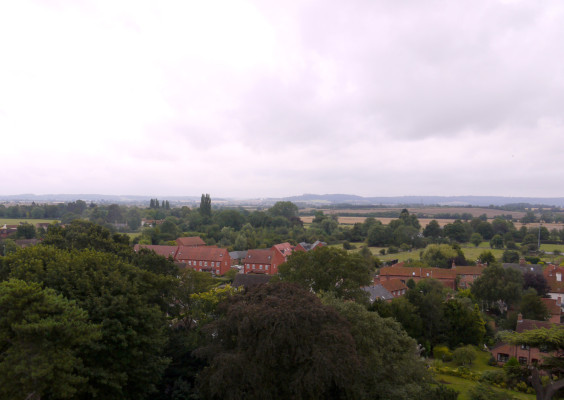 The view towards the castle today, 2014. In this contemporary picture the most conspicuous feature is the small estate of houses built only recently on the southern side of Grantham Road, though Daybell's Barn and Farmhouse are also clearly visible. Fields still extend the the horizon, and Belvoir Castle stands proud upon its hilltop. Easthorpe nestles hidden among its trees, and the congestion of the A52 bypass is mercifully hard to spot.