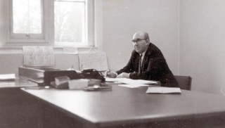 Retired from the police force, behind the desk at St Vincents Dept of Works, Grantham, 1969.
