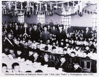 Press photograph of a Christmas Breakfast at the Dakeyne Street club