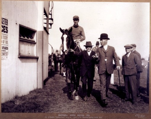 Alec Marsh is the jockey being led by his father at Southwell Races.