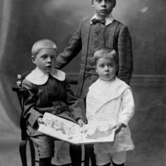 Three of the sons: Cyril (seated), George Ernest junior (at rear) and Alec Marsh (on right)