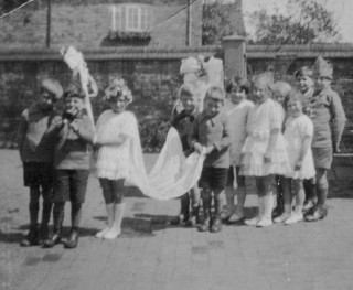 1920s Bottesford Junior School May Queen procession - Mrs Ada Bond recalls that the May Queen was Eva Randall; others in the procession include George Taylor, Ralph Bateson, Joan Tuckwood (Mrs Joan Roberts), Betty Waudby and Bill Waudby