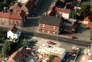 Late 1970s aerial view of Ted's Garage and No. 11 High Street . The barn to the rear is under conversion