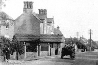 This gabled house with the tall chimneys was at one time occupied by Dr. Wright and may have been no. 12 High Street on the 1881 census.