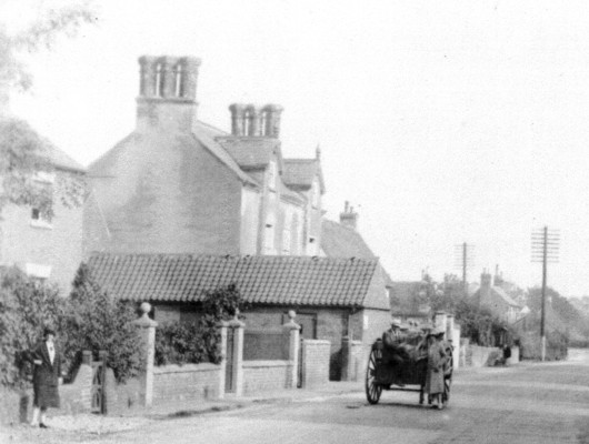 Detail of picture 1. Cart approaching Claremont House. Can anyone identify the people in this picture?