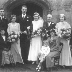 Annie Elizabeth Bray's wedding to Mr. Abbott at Muston church 1934. My great grandmother has Gerald Coy sitting at her knee with my great grandfather and Clarice Bray behind her.