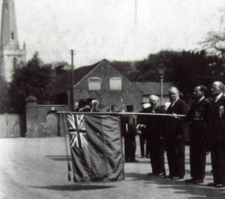 Near the Cross where many would have volunteered - lowering the standard on Armistice Day in the 1920/30s