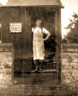 Mr. Arthur Wing outside his shoe repair shop