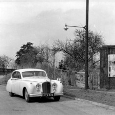 Mr. Houghton Ward's car outside Greaves Cycles & Electricals, 1955.