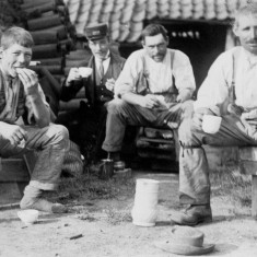 Three generations of brick makers sharing tea break, along with a fourth man in the uniform of a railway employee   From the collection of Mrs Jean Round
