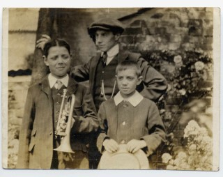 Bob Sutton (left) holding a cornet; Philip Sutton, his cousin, wearing a hat. Frank Sutton his younger brother, holding a straw hat. Frank died in 1919 a casualty of the Spanish Flu epidemic. Philip served in the Durham Light Infantry. He survived injury at the  Somme in September 1916. He was killed in the March 1918 German Offensive.