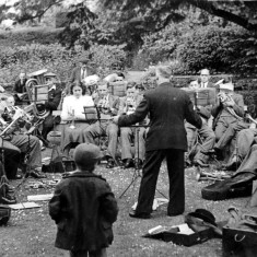 Bingham and Bottesford band playing in the rectory garden at Bingham, c.1930. Bob Sutton, wearing a cap, is playing the cornet.