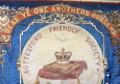 Why Did the Friendly Society Change Its Motto?
