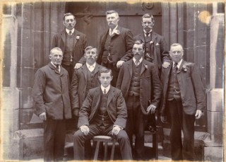 The bellringers at Bottesford St Mary's on Coronation Day, 1911. Back row standing L-R: Reuben Bend, Samuel Baker, Harris Thorlby. Front row standing L-R: Daniel Gilding, Arthur W Ward, John W Kirton, Mark Bend. Front seated: Charles Lamb. | Bottesford Heritage Archive