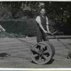 Tommy Robinson, left, rolling the lawn as Bill Sutton marks the lines for a bowling match at the Rectory, Bottesford, 1920/30s. | Bottesford Heritage Archive, from the collection of Bill Sutton.