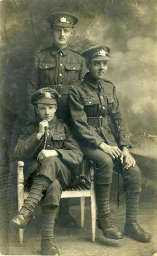 Pte Bob Sutton (seated right) with two other recruits to the Manchester Regiment. Taken at the JW Hardy Studio, Cleethorpes. Note the new looking footwear. Manchester Archive+