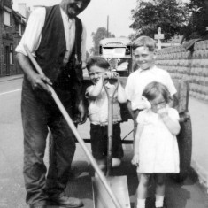 Joe (grandad) roadsweeping (being helped/hindered by George,Jeff and Jean).Randall's bus in the background.