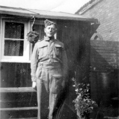 Henry (uncle) wearing Pioneer Corps uniform in the yard at Retford Cottages