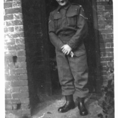 Joe (dad) wearing Home Guard uniform in the yard at Retford Cottages